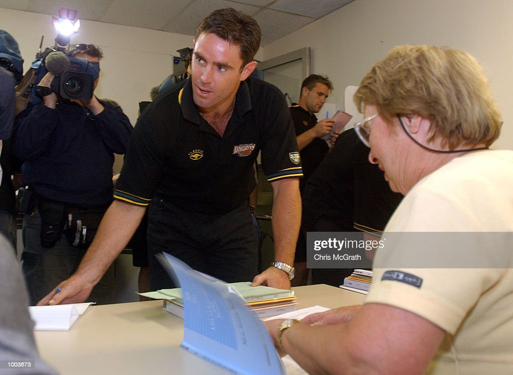 Brad Fittler sorts through the paper work at the Pre Poll Voting office before casting his Australian Federal Election vote before leaving on the Kangaroo Tour of England. Voting was held at Eastern gardens, Sydney, Australia. DIGITAL IMAGE Mandatory Credit: Chris McGrath/ALLSPORT