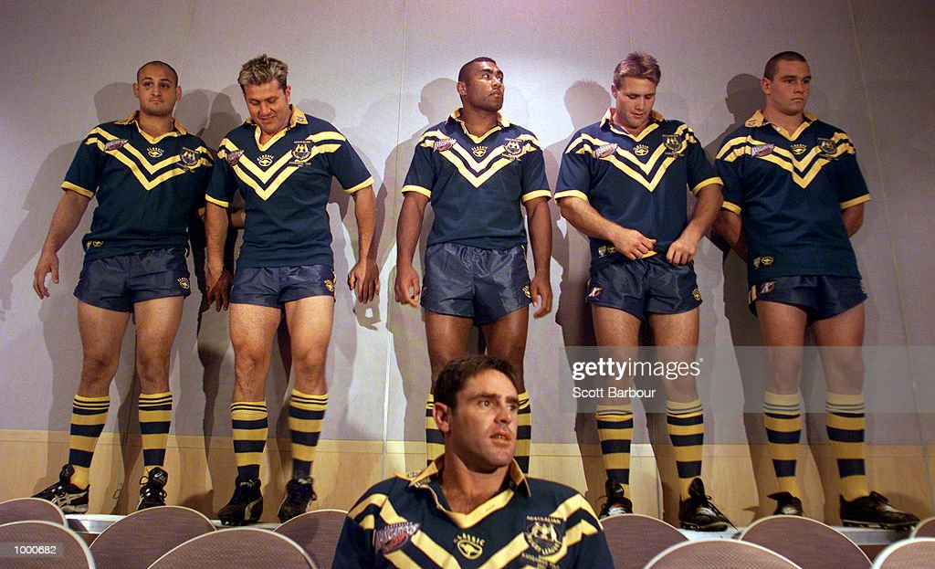 Captain Brad Fittler (front) looks on as team members get in place during the Australian rugby league teams team photo session held at the Coogee Bay Plaza in Sydney, Australia. DIGITAL IMAGE. Mandatory Credit: Scott Barbour/ALLSPORT