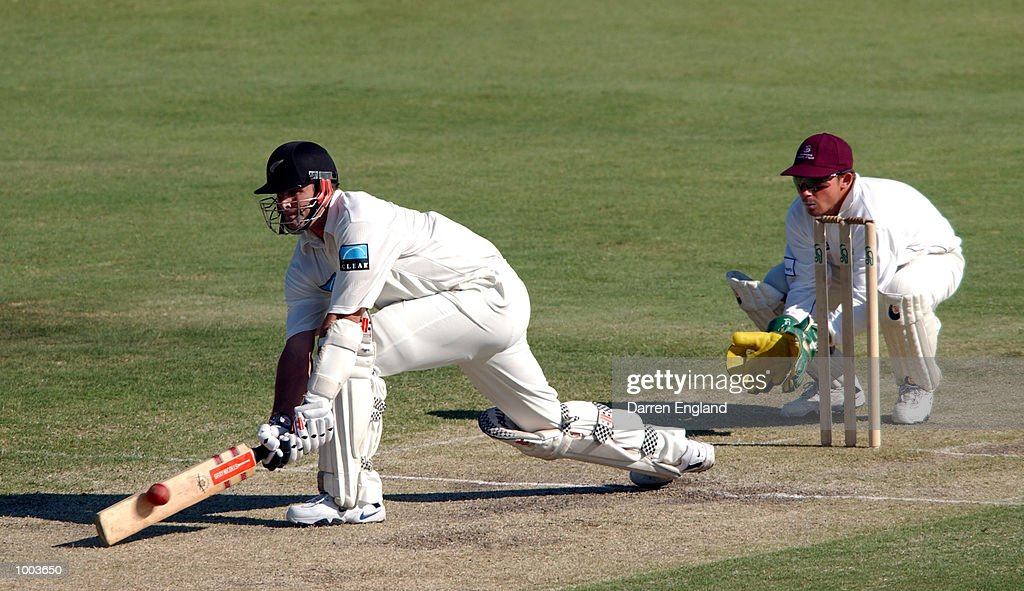Chris Cairns of New Zealand hits four runs against Queensland during the New Zealand cricket teams tour match against the Queensland Academy of Sport at Allan Border Field in Brisbane, Australia. DIGITAL IMAGE. Mandatory Credit: Darren England/ALLSPORT