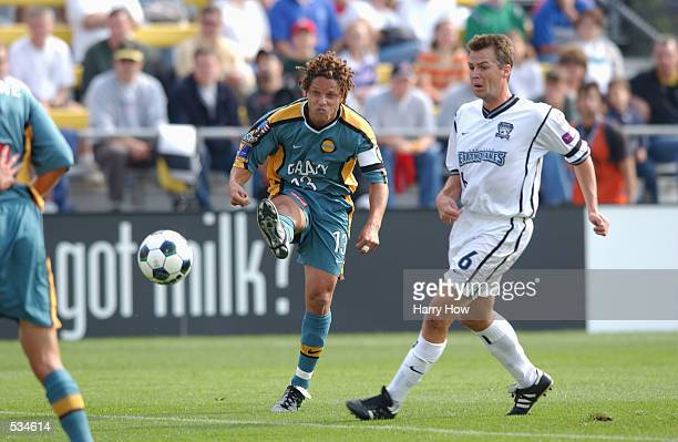 Cobi Jones of the Los Angeles Galaxy kicks the ball past Ronnie Ekelund of the San Jose Earthquakes in the Major League Soccer Cup at the Columbus...