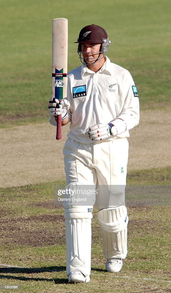 Craig McMillan of New Zealand celebrates scoring a century against the Queensland Academy of Sport during the tour match at Allan Border Field in Brisbane, Australia. DIGITAL IMAGE. Mandatory Credit: Darren England/ALLSPORT