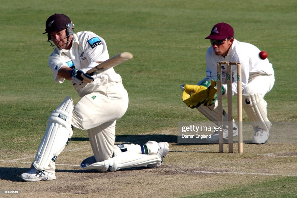 Craig McMillan of New Zealand hits four runs against Queensland during the New Zealand cricket teams tour match against the Queensland Academy of Sport at Allan Border Field in Brisbane, Australia