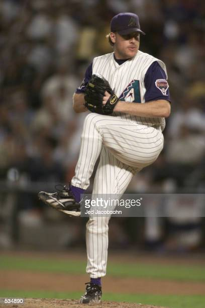Curt Schilling of the Arizona Diamondbacks delivers a pitch against the New York Yankees during Game 1 of the World Series at Bank One Ballpark in...