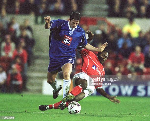 David Johnson of Nottingham Forest tries a sliding tackle on Curtis Woodhouse of Birmingham City during the Nationwide First Division game between...