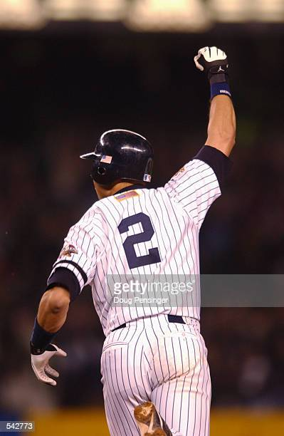 Derek Jeter of the New York Yankees celebrates his game winning home run in the 11th inning against the Arizona Diamondbacks during game four of the...