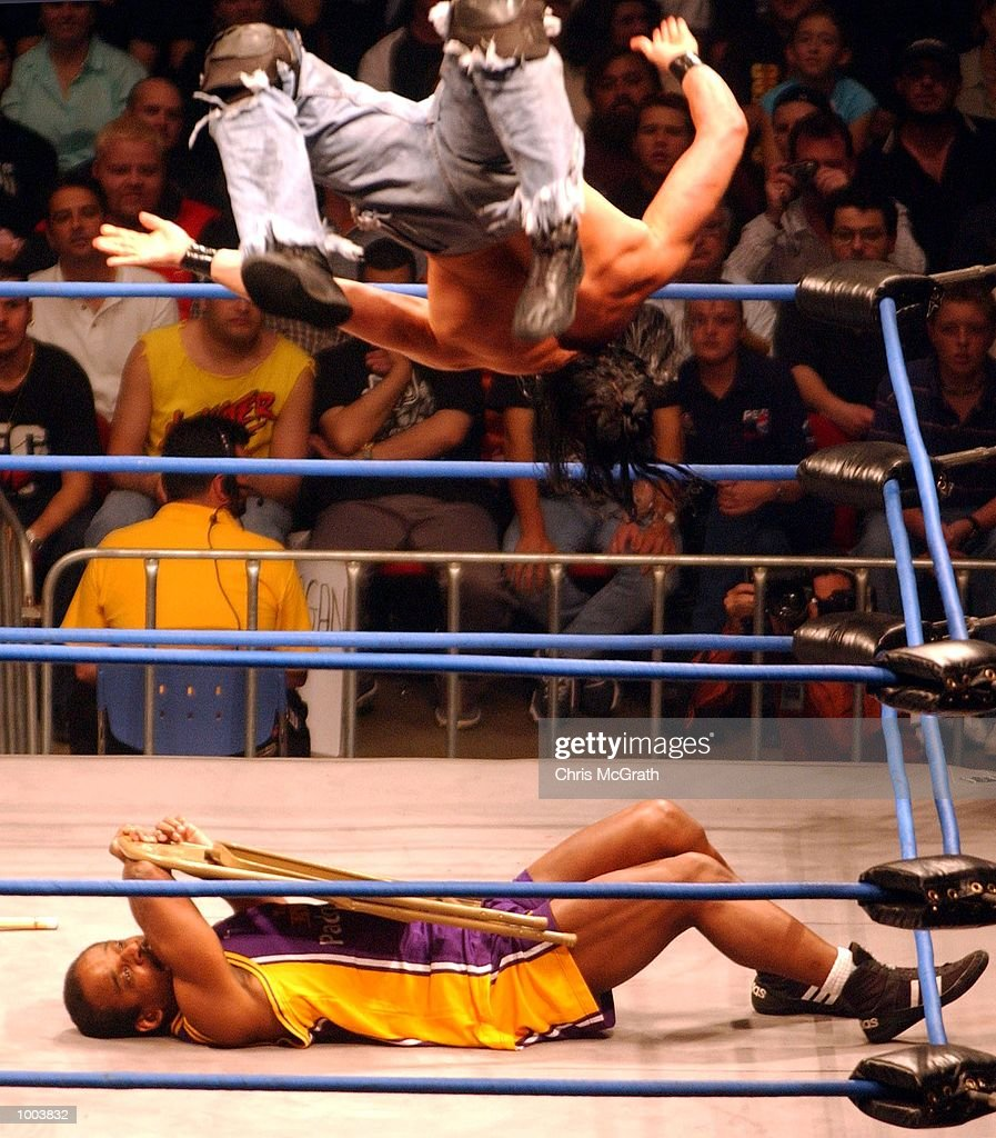 Devon Storm flies high over Norman Smiley during the Hardcore Match at the WWA Wrestling 'Inception' fight night held at the Sydney Superdome, Sydney, Australia. DIGITAL IMAGE Mandatory Credit: Chris McGrath/ALLSPORT