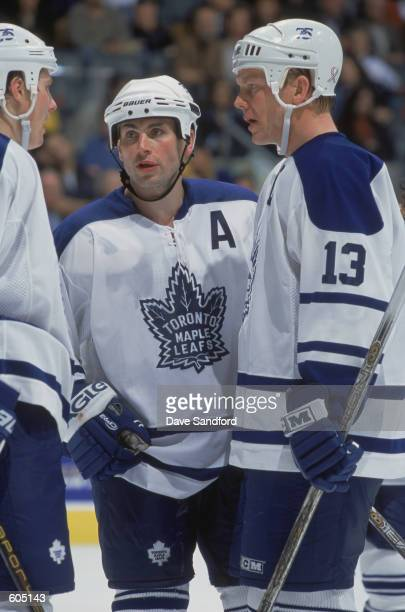 Dmitry Yushkevich of the Toronto Maple Leafs talks to teammate Mats Sundin during the game against the Boston Bruins during the game at the Air...