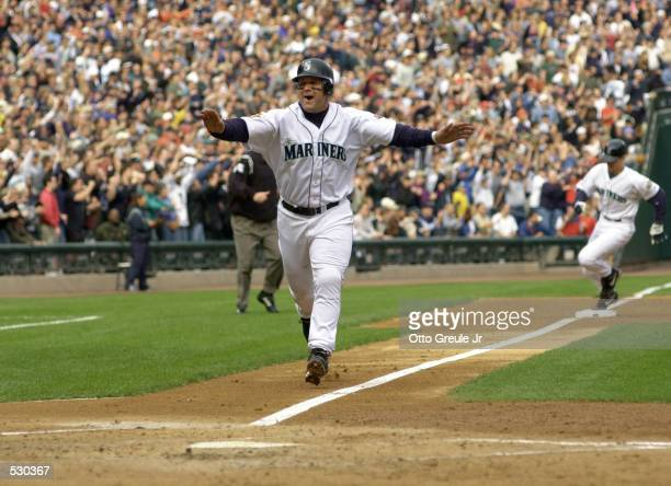 Edgar Martinez of the Seattle Mariners score the first run against the Cleveland Indians during the second inning of the American League Divisional...