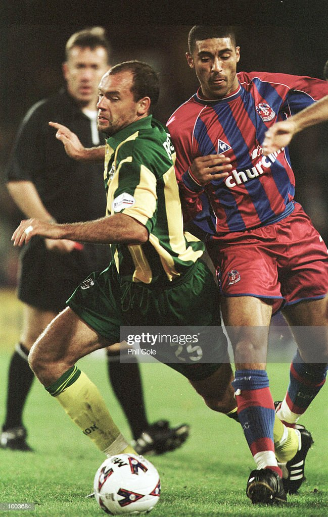 Hayden Mullins of Crystal Palace is challenged by Uwe Rosler of West Brom during the Nationwide League Division One match between Crystal Palace and West Bromwich Albion at Selhurst Park, London. Mandatory Credit: Phil Cole/ALLSPORT