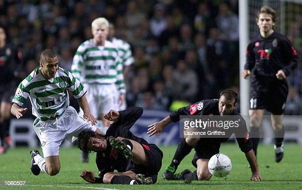 Henrik Larsson of Celtic battles for the ball with Alessio Tacchinardi and Alessandro Birindelli of Juventus during the Champions League game between...