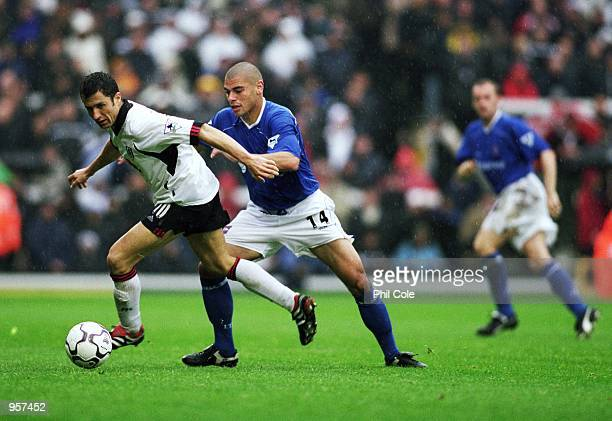 John Collins of Fulham and Jermaine Wright of Ipswich challenge for the ball during the FA Barclaycard Premiership match between Fulham and Ipswich...
