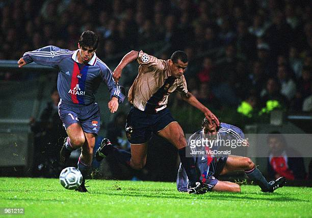 Juninho of Lyon and Rivaldo of Barcelona challenge for the ball during the UEFA Champions League match between Olympic Lyonnais and Barcelona played...