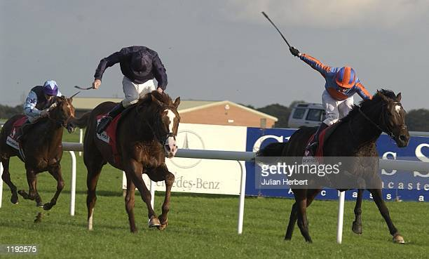 Kevin Darley and High Chaparral get the better of the George Duffield ridden Castle Gandolfo to land The Racing Post trophy run at Doncaster DIGITAL...