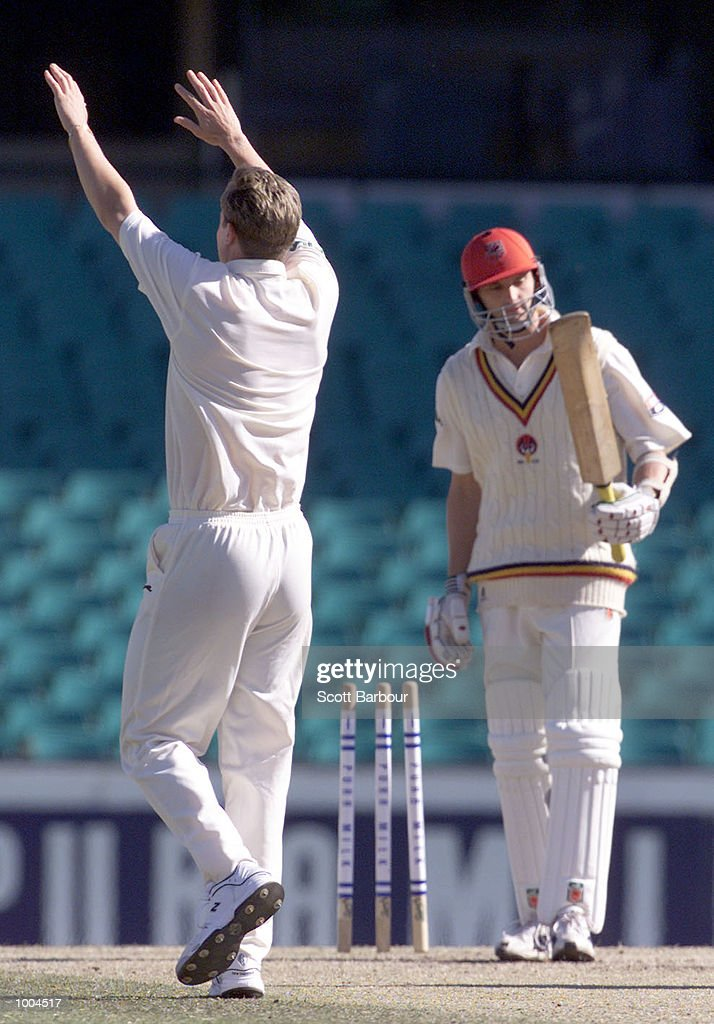 Last man out Mark Harrity of South Australia looks at his bat after being bowled by Nathan Bracken of New South Wales during day three of the Pura Cup match held at the Sydney Cricket Ground in Sydney, Australia. DIGITAL IMAGE. Mandatory Credit: Scott Barbour/ALLSPORT