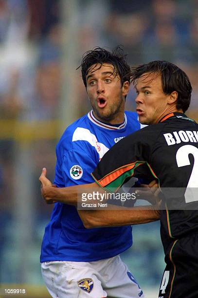 Luca toni of Brescia and Joachim Bjorklund of Venezia in action during the Serie A 9th Round League match between Brescia and Venezia played at the...