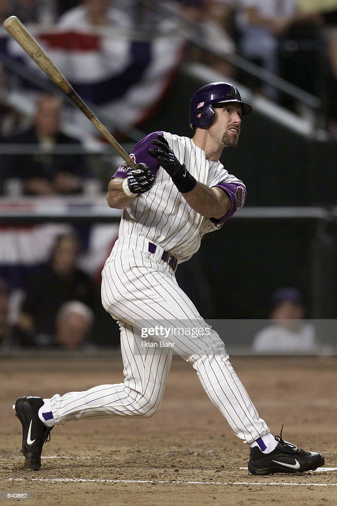 Luis Gonzalez of the Arizona Diamondbacks hits a 2run home run against the New York Yankees during Game 1 of the of the Major League World Series at...
