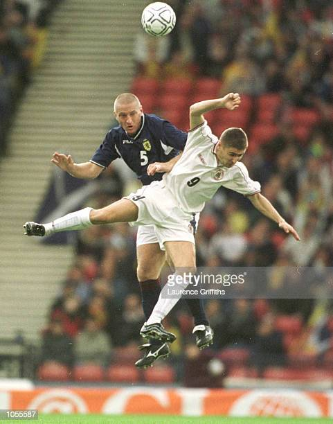 Marian Pahars of Latvia battles with Matt Elliott of Scotland during the match between Scotland and Latvia in the 2002 World Cup Qualifying Group 6...