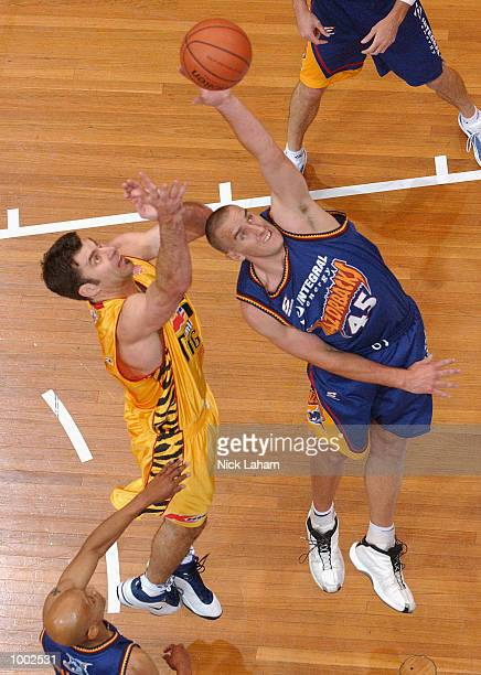 Mark Bradtke of the Tigers and Simon Dwight of the Razorbacks in action during the NBL match between the Melbourne Tigers and the West Sydney...