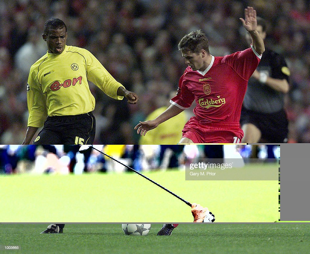 Michael Owen of Liverpool slips past Sunday Oliseh during the UEFA Champions League match between Liverpool and Borussia Dortmund at Anfield, Liverpool. DIGITAL IMAGE. Mandatory Credit: Gary M. Prior/ALLSPORT