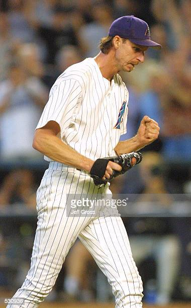 Pitcher Randy Johnson of the Arizona Diamondbacks pumps his fist after striking out Brian Jordan of the Atlanta Braves and winning game one of the...