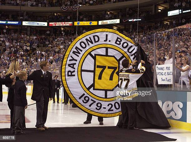 Ray Bourque of the Boston Bruins uncovers his number during a ceremony in which the Bruins retired his number before their home opener against the...