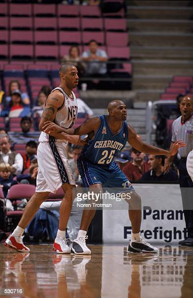 Richard Jefferson of the Charlotte Hornets blocking out Kenyon Martin from the basket during the preseason game against the New Jersey Nets at the...