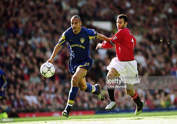 Rio Ferdinand of Leeds gets the better of Man Utd's Ryan Giggs during the FA Barclaycard Premiership match between Manchester United and Leeds United...