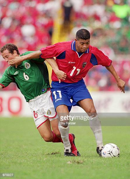 Ronald Gomez of Costa Rica shields the ball during the FIFA 2002 World Cup Qualifier between Costa Rica and Mexico played at the Estadio Nacional in...