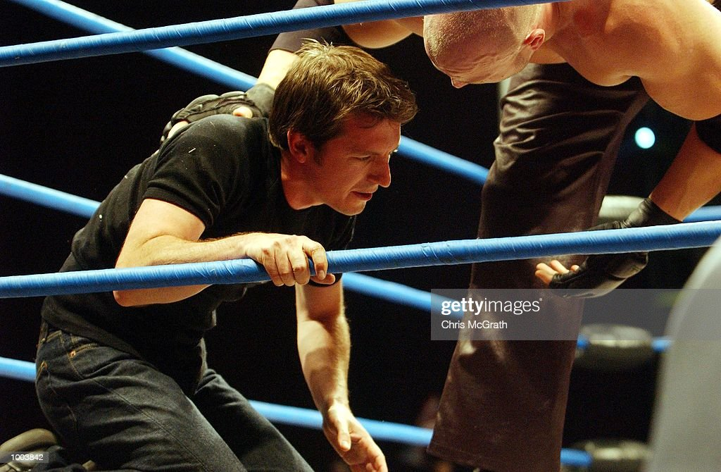 Rove McManus recovers after being smashed by a guitar during the WWA Wrestling 'Inception' fight night held at the Sydney Superdome, Sydney, Australia. DIGITAL IMAGE Mandatory Credit: Chris McGrath/ALLSPORT