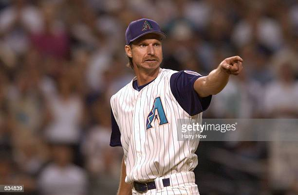 Starting pitcher Randy Johnson of the Arizona Diamondbacks signals to his team against the New York Yankees during game two of the Major League...