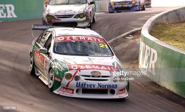 The Ozemail Internet Racing team of Brad Jones and John Cleland negotiate the Dipper during the Bathurst 1000 V8 Supercar race held at Mt Panormama...