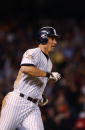 Tino Martinez of the New York Yankees circles the bases after hitting a two run home run in the 9th inning to tie the Arizona Diamondbacks during...