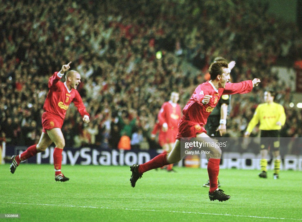 Vladimir Smicer of Liverpool celebrates scoring the opening goal during the UEFA Champions League match between Liverpool and Borussia Dortmund at Anfield, Liverpool. Mandatory Credit: Gary M. Prior/ALLSPORT