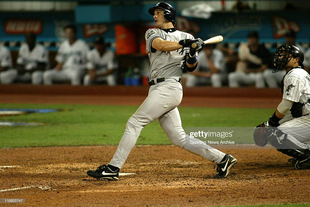 Aaron Boone of the New York Yankees hits a home run during the Yanks' 6-1 victory over the Florida Marlins in game 3 of the World Series at Pro Player Stadium in Miami, FL..