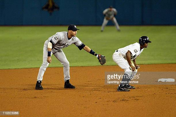 Derek Jeter of the New York Yankees keeps Juan Pierre of the Marlins close to the bag during the Yanks' 61 victory over the Florida Marlins in game 3...