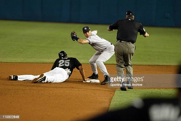 Derek Jeter of the New York Yankees looks at the ump for a call during the Yanks' 43 loss to the Florida Marlins in game 4 of the World Series at Pro...