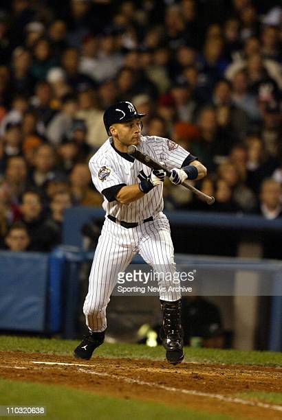 Derek Jeter of the New York Yankees squares around to bunt during the Yanks' 32 loss to the Florida Marlins in game 1 of the World Series at Yankee...