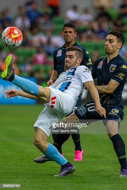 Ben Garuccio of Melbourne City controls the ball while attempting to kick the ball in front of Anthony Caceres of the Central Coast Mariners during...