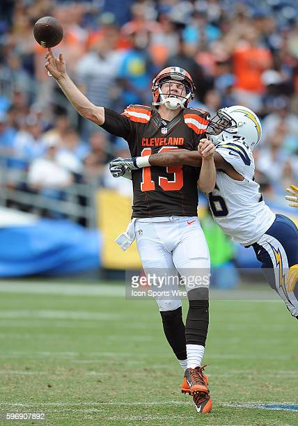 Cleveland Browns quarterback Josh McCown is hit by San Diego Chargers cornerback Patrick Robinson as he releases the ball during a game played at...