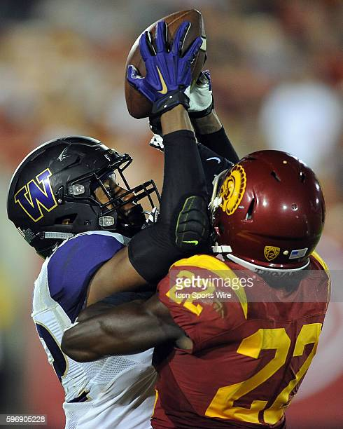 Washington Huskies tight end Joshua Perkins tries to catch a pass over USC Trojans free safety Leon McQuay III but Perkins has the pass knocked away...