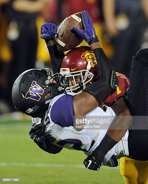 Washington Huskies tight end Joshua Perkins tries to catch a pass over USC Trojans safety Marvel Tell III but Perkins drops the ball during a game...