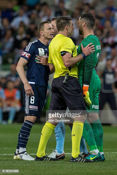 Besart Berisha of Melbourne Victory and Dean Bouzanis of Melbourne City have words during the Semifinal of the 2016 FFA Cup between Melbourne City...