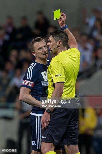 Besart Berisha of Melbourne Victory earns a yellow card after his altercation with Dean Bouzanis of Melbourne City and Michael Jakobsen of Melbourne...