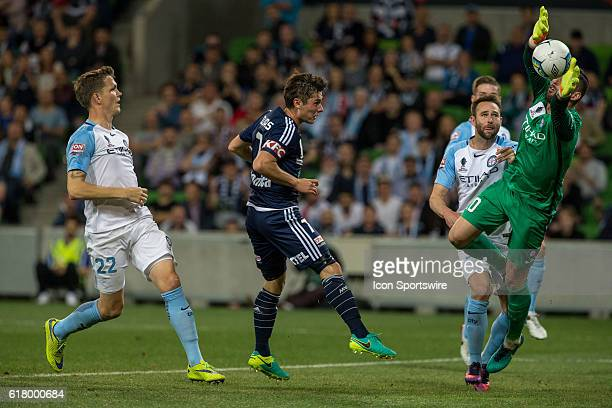 Dean Bouzanis of Melbourne City attempts to stop Marco Rojas of Melbourne Victory's disallowed goal during the Semifinal of the 2016 FFA Cup between...