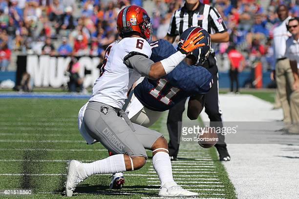 Kansas Jayhawks wide receiver Steven Sims Jr can't make the catch against Oklahoma State Cowboys cornerback Ashton Lampkin in a Big 12 matchup...