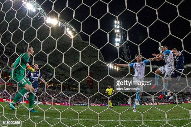 Manny Muscat of Melbourne City and Besart Berisha of Melbourne Victory contest the ball right in front go the goal during the Semifinal of the 2016...