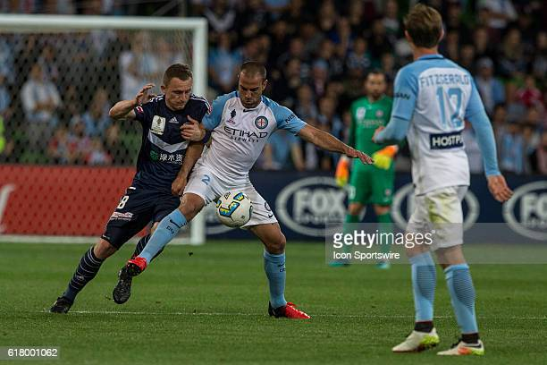 Manny Muscat of Melbourne City and Besart Berisha of Melbourne Victory contest the ball during the Semifinal of the 2016 FFA Cup between Melbourne...