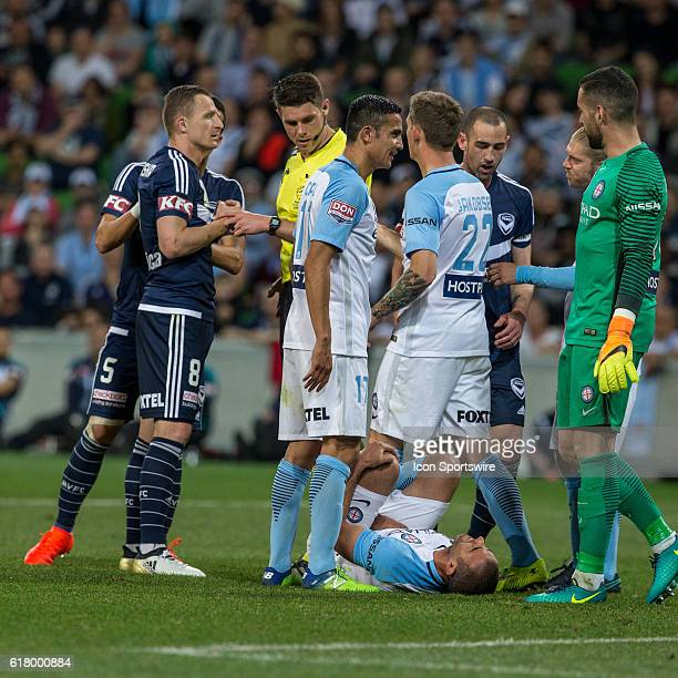 Manny Muscat of Melbourne City lies on the field injured after a contest for the ball with Besart Berisha of Melbourne Victory and Michael Jakobsen...