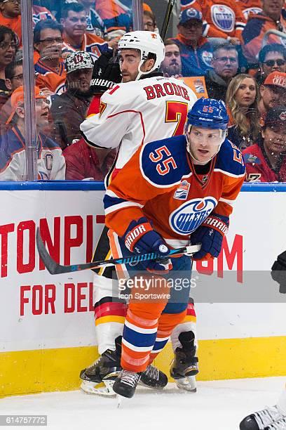 Mark Letestu of the Edmonton Oilers checks TJ Brodie of the Calgary Flames in the corner during the Calgary Flames versus the Edmonton Oilers hockey...