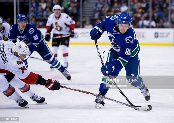25 Oct 2016 Ottawa Senators Defenceman Mark Borowiecki attempts to check Vancouver Canucks Center Markus Granlund during a game at Rogers Arena in...